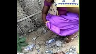 Tamil wife pee in Front of husband in outdoor